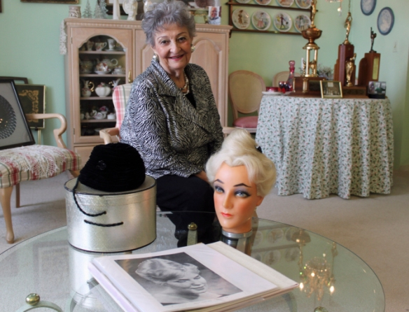 "In this photo taken Jan. 19, 2011, retired hairstylist Margaret Vinci Heldt, 92, is seen at her apartment in Elmhurst, Ill. Heldt developed ""the beehive"" hairdo when Modern Beauty Shop magazine was looking for a new design, something new and different to feature in its February 1960 issue. The black velvet hat on the table was the inspiration for the hairdo. (AP Photo/Caryn Rousseau)"